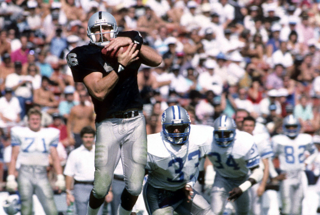 In this Sept. 20, 1997 photo provided by the NFL, Los Angeles Raiders tight end Todd Christensen (46) makes a grab during a 27-7 victory over the Detroit Lions at Los Angeles Memorial Coliseum in  ...