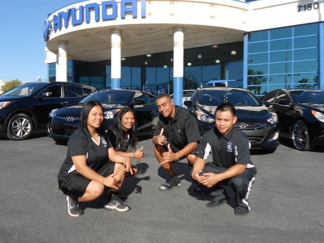 This family purchased four vehicles from Planet Hyundai Sahara at 7150 W. Sahara Ave. They are, from left, Kendrell Santiago (2013 Hyundai Elantra); Prisca Clipper, (2013 Hyundai Santa Fe); Presto ...