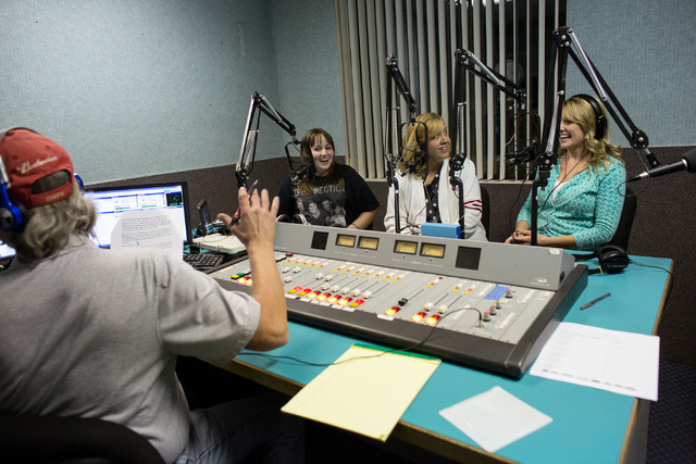 """Producer Mike Fox, left, Corey Taylor, second from left, and teachers Mary Abbott, third from left, and Tommi Garza (cq), right, record the weekly talk radio show, """"Corey Taylor Talks,""""  ..."""