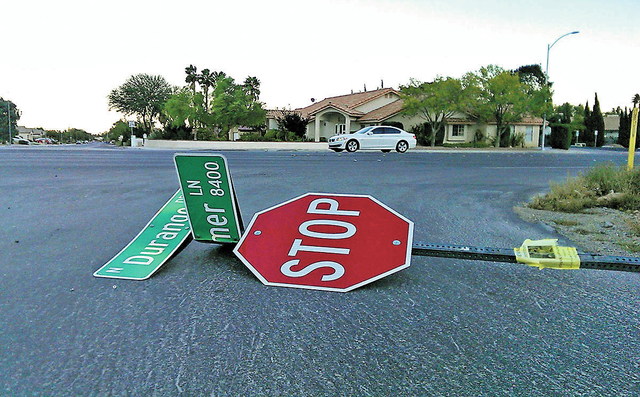 After strong winds buffeted the valley, a stop sign lies on its side Oct. 28, 2013, at the corner of Durango Drive and Hammer Lane in Centennial Hills, Las Vegas. (JEFF MOSIER/VIEW)