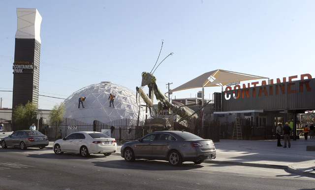 Two workmen finish work on the outside of a geodesic dome in the Container Park in downtown Las Vegas, Wednesday, Nov. 20, 2013. The area will have a soft opening on Saturday. (Jerry Henkel/Las Ve ...