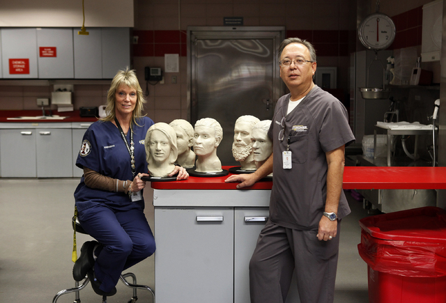 Forensic pathology technician Suzanne Miele and investigative forensic supervisor Bill Gazza work in the Clark County coroner's office. (John Locher/Las Vegas Review-Journal)