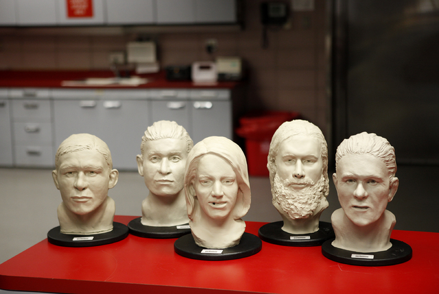 Facial estimations of unidentified dead people are seen at the Clark County coroner's office in Las Vegas. (John Locher/Las Vegas Review-Journal)