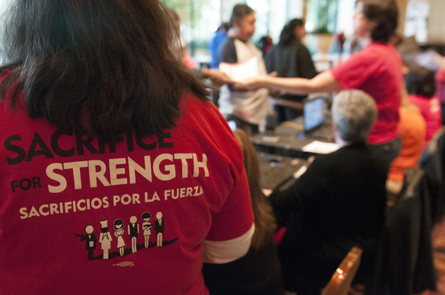 Staff volunteer Meredith Schafer wears a union T-shirt during a meeting to vote for a new Culinary contract at the MGM Grand Conference Center in Las Vegas on Wednesday. (Erik Verduzco/Las Vegas R ...