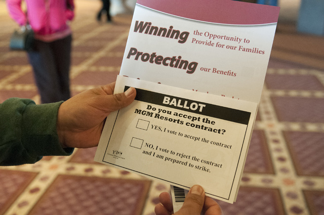 Union member Lorenzo Meneses-Aguil shows his ballot to vote for a new Culinary contract at the MGM Grand Conference Center in Las Vegas on Wednesday. (Erik Verduzco/Las Vegas Review-Journal)