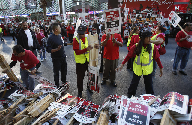 Culinary Union members prepare to protest in front of the Cosmopolitan hotel and casino in Las Vegas Friday, Nov. 1, 2013. (John Locher/Las Vegas Review-Journal)