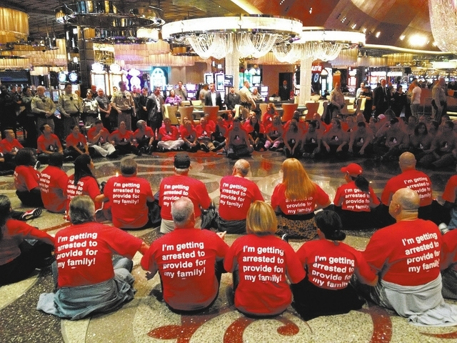 Culinary Union members protest inside of the Cosmopolitan hotel and casino in Las Vegas Friday, Nov. 1, 2013. (John Locher/Las Vegas Review-Journal)
