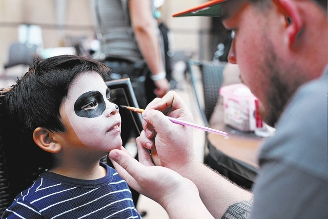 Robert Zaragoza paints the face of 4-year-old Mateo Batalla at the Day of the Dead celebration at Springs Preserve on Friday, Nov. 1, 2013. (Alex Federowicz/Las Vegas Review-Journal)