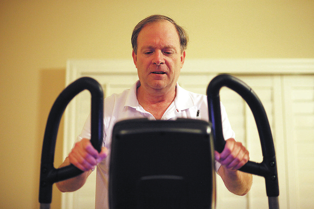 Kip Smith works out in his home in Las Vegas Tuesday, Nov. 19, 2013. Smith had undergone deep brain stimulation for his Parkinson's Disease. (John Locher/Las Vegas Review-Journal)