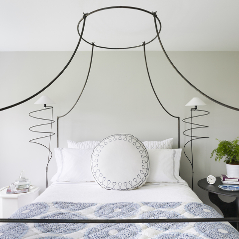 Mayhew had the light fixture in her guest room altered to fit in Anthropologies Italian Campaign canopy bed. (Dylan Chandler/Special to the Washington Post)