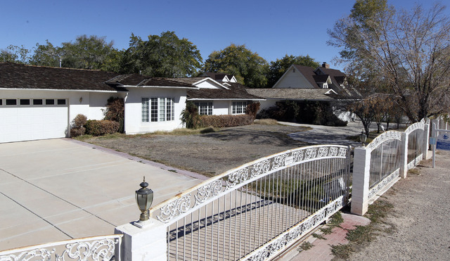 The Ted Binion house is seen on Palomino Lane in Las Vegas, Wednesday, Oct. 30, 2013. The property has been on the market for five years. One of the reasons given for it's non-sale is that Binion  ...