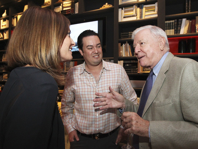 Katie O'Neill and Sam Cherry, center, listen to Geoffrey Beaumont, right, at the announcement of the proposed new Modern Museum of Contemporary Art at a gathering in the Lady Silvia in Las Vegas,  ...