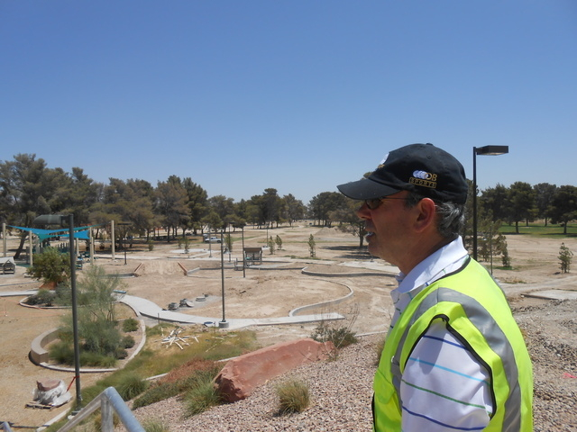 North Las Vegas Parks and Recreation Deputy Director Mike Henley looks out over unfinished playgrounds Wednesday, May 22, 2013, five months before the opening of Craig Ranch Regional Park. (File,  ...