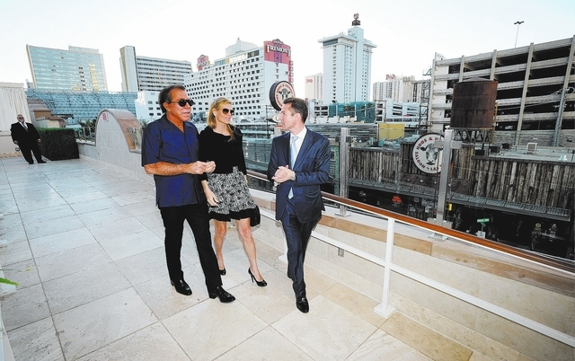 Seth Schorr, right, CEO of the Downtown Grand Las Vegas  gives Steve and Andrea Wynn, a tour of the now open  hotel and casino on Sunday, Oct. 27, 2013.  Steve Wynn was invited to make the first b ...