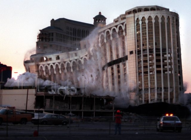 The Dunes hotel-casino collapses under its own weight as it is imploded on the Las Vegas Strip, April 27, 1998. The casino was destroyed in order to make room for the proposed Aladdin resort-casin ...