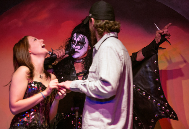 Tiffannie Dorsey, left marries Jay Dorsey, right, as Pat Vitagliano officiates the ceremony as Gene Simmons on Thursday, Oct. 31, 2013 at KISS by Monster Mini Golf. Vitagliano and his wife, Christ ...