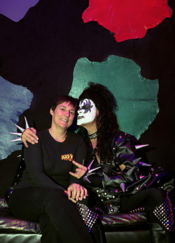 Christina and Pat Vitagliano pose inside the VIP room of KISS by Monster Mini Golf. The couple, who married at the Graceland Wedding Chapel 16 years ago, opened a KISS-themed business - complete w ...