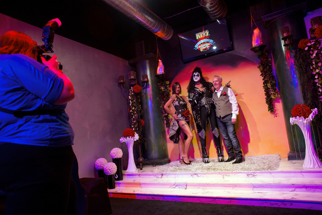Sheila Service, left, Pat Vitagliano, center, and Vic Service, right, pose for wedding portraits after the Services got married Thursday, Oct. 31, 2013 at KISS by Monster Mini Golf. (Samantha Clem ...