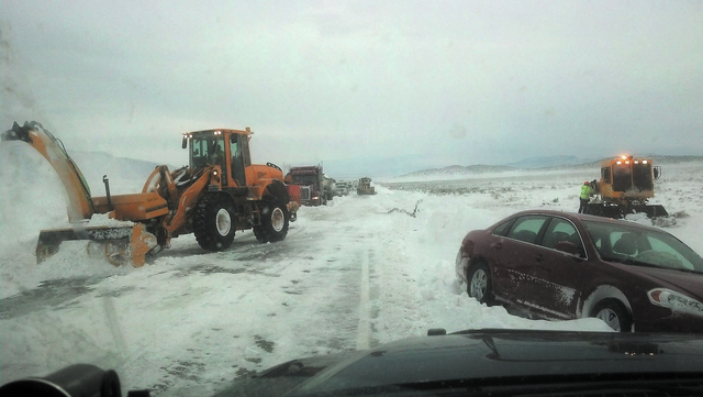 Heavy equipment clears snow from the roadway on U.S. Highway 93 on Friday. At least 50 drivers were stranded when heavy snowfall covered the road between Ely and Pioche. Motorists were trapped for ...