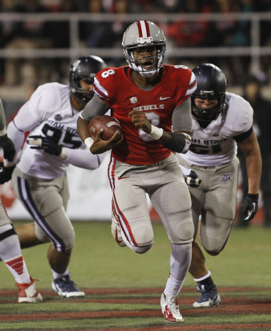 UNLV quarterback Caleb Herring (8) looks to run against Utah State during their football game at Sam Boyd Stadium in Las Vegas on Nov. 9, 2013. (Jason Bean /Las Vegas Review-Journal)