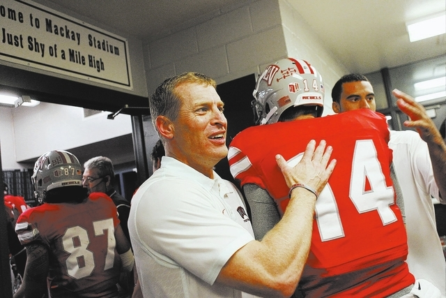 UNLV coach Bobby Hauck, shown greeting his players after the Rebels' 27-22 win over UNR on Oct. 26, has been awarded a new three-year contract, taking him through 2016. (Jason Bean/Las Vegas Rev ...