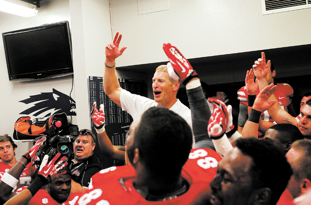 UNLV head coach Bobby Hauck celebrates with his players after defeating UNR at Mackay Stadium in Reno on Oct. 26, 2013. (Jason Bean/Las Vegas Review-Journal)