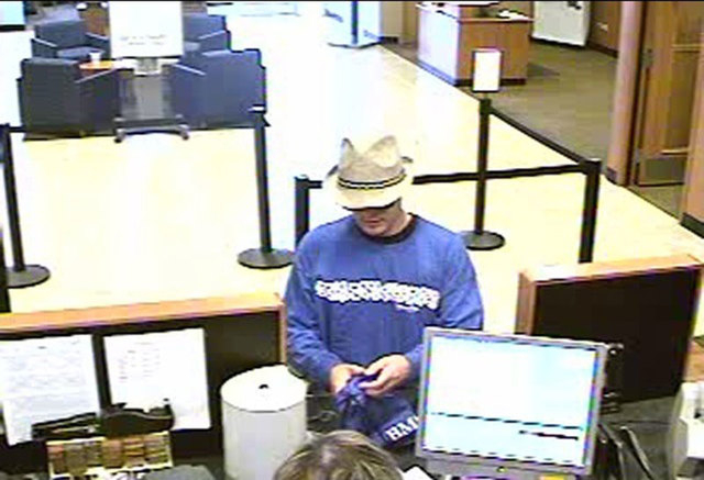 Henderson police are searching for a man in connection with a series of bank robberies during the past two months. The suspect is known for wearing hats during the robberies.