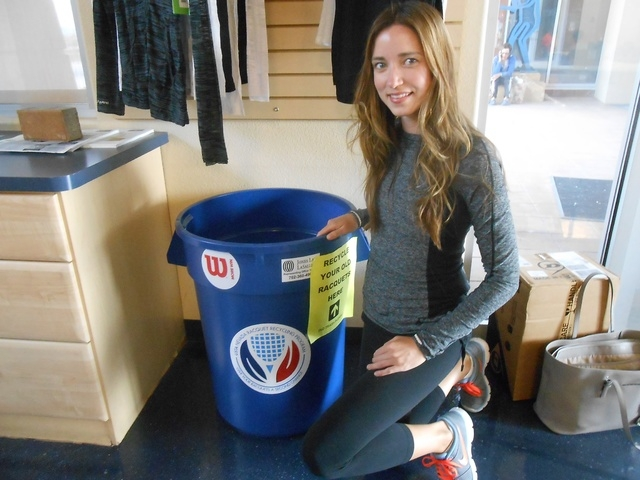 Janay Oakland, tennis representative for the United States Tennis Association-Nevada, pauses Oct. 7 to check one of the 10 bins she's placed around Las Vegas to collect tennis rackets. This one  ...