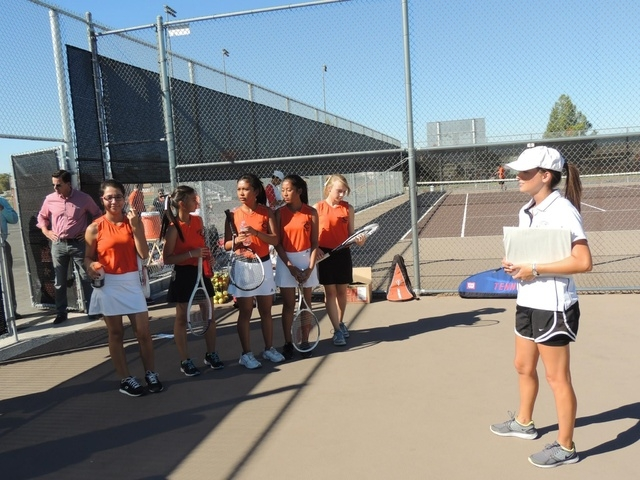 Coach Karryn Hirsch from Teach for America gets the Chaparral High School girls tennis team ready to hit the courts, Sept. 30. The high school's boys and girls tennis teams received free, refurbis ...
