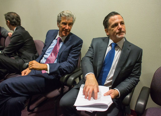 Attorney Lloyd Levenson, left, and Cleveland Cavaliers owner Dan Gilbert, talk before meeting with Nevada State Gaming Control Board members Wednesday inside the Grant Sawyer Building. Gilbert's c ...