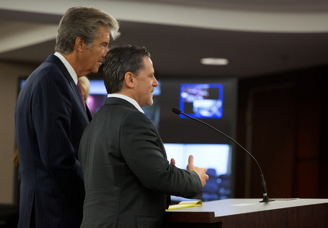 Attorney Lloyd Levenson, left, and Cleveland Cavaliers owner Dan Gilbert, talk with Nevada State Gaming Control Board members Wednesda inside the Grant Sawyer Building. Gilbert's company, Rock Gam ...