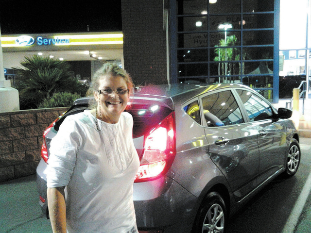 Las Vegas resident Ginger Dearing stands by her 2013 Hyundai Accent purchased at Planet Hyundai Sahara. She traded in a 1997 Ford Contour during the dealership's recently completed Cash for Clun ...