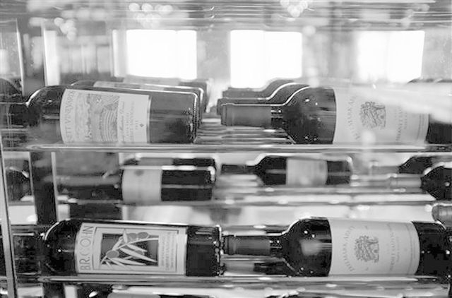 In this Tuesday, Oct. 29, 2013 photo, bottles of California wine are displayed inside the 630 Park Steakhouse at the Graton Resort and Casino in Rohnert Park, Calif.  The Las Vegas-style Indian ca ...