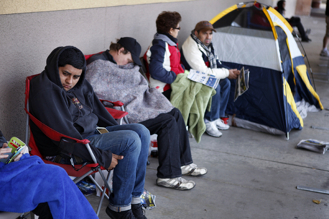 Chris Grizzly, left, waits in line at Best Buy on Maryland Parkway on Thursday, Nov. 28, 2013. Grizzly had been waiting in line since 8 p.m. Wednesday. (John Locher/Las Vegas Review-Journal)