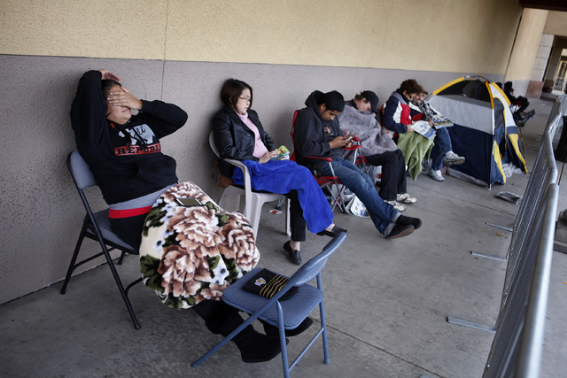 April Salvador, left, rubs her face as she waits in line at Best Buy on Maryland Parkway on Thursday. Slavador had been waiting in line since 7 p.m. Wednesday. (John Locher/Las Vegas Review-Journal)