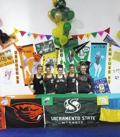 Five local gymnasts gather to sign national letters of intent Nov. 19 at Gymcats, 440 Parkson Road. From left, Danielle Dessaints of Foothill High School plans to go to Oregon State University. Ca ...