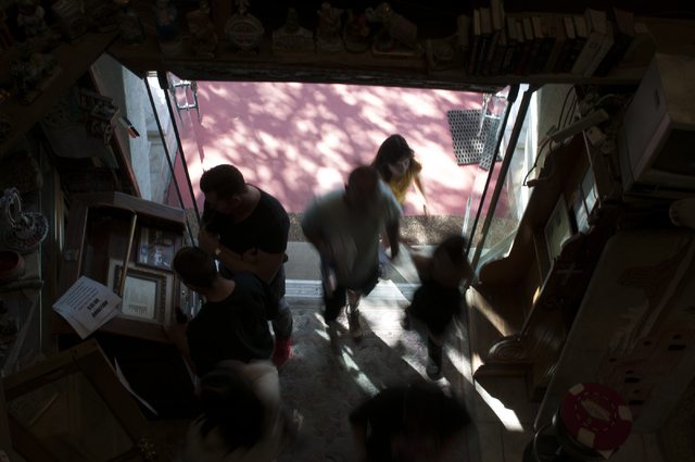 Visitors are seen entering the home of former Lt. Gov. Lonnie Hammargren during an open house tour of his historical collections in Las Vegas, Saturday, Nov. 2, 2013. (Erik Verduzco/Las Vegas Revi ...