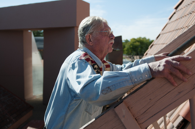 Former Lt. Gov. Lonnie Hammargren is seen going up to the roof of his home during an open house tour of his historical collections in Las Vegas, Saturday, Nov. 2, 2013.  (Erik Verduzco/Las Vegas R ...
