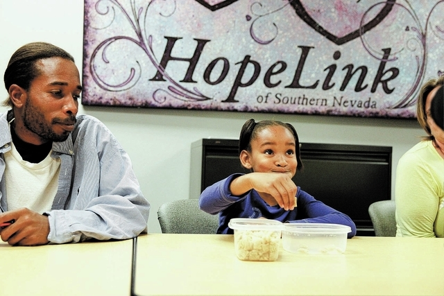 Kiairra Jones and her father Nickolas Jones sample what Kiairra believes to be equal to a one-cup serving during a 10-week course on budget management and food choices at HopeLink,178 Westminster  ...