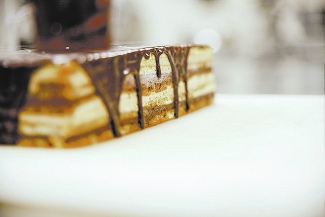 A recently glazed cake cools at Gimme Some Sugar Bake Shoppe 19 S. Stephanie St. Henderson, Tuesday, Nov. 19, 2013.  The shop is due to open its new dessert and wine bar Nov. 29, 2013.  (Robert Wi ...