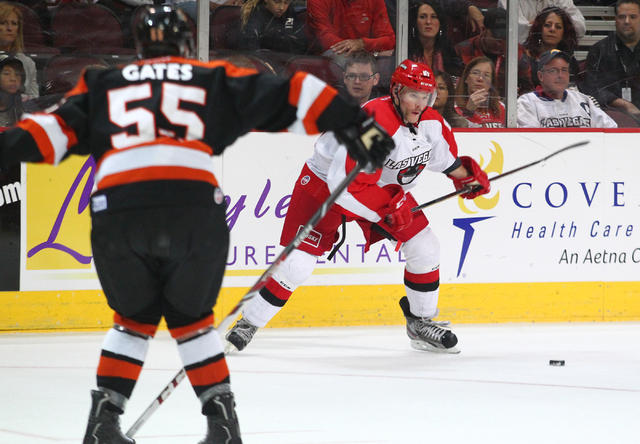 Las Vegas Wranglers' Geoff Irwin aims to pass the puck while playing against the Fort Wayne Komets at the Orleans Arena in Las Vegas on Saturday, Nov. 2, 2013. (Chase Stevens/Las Vegas Review-Journal)