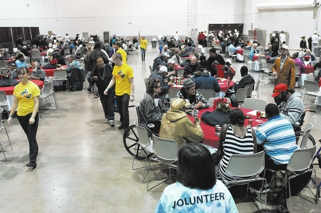 People are seen having a meal prepared by students in the Culinary Academy of Las Vegas during the annual Homeless Connect event at Cashman Center in Las Vegas on Tuesday, Nov. 19, 2013. The event ...