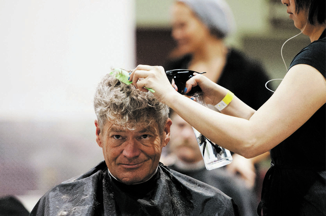 Todd Knight, gets a free hair by Rachel Dombrigues, volunteer hair stylist, during the annual Homeless Connect event at Cashman Center in Las Vegas on Tuesday, Nov. 19, 2013. The event offered hom ...