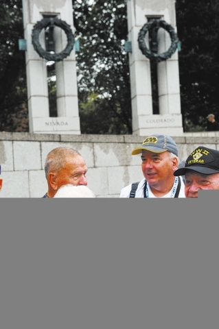 World War II Veteran Katherine Dupont stands with a group of World War II Veterans for a photo opportunity at the World War II memorial Saturday October 12, 2013 in Washington DC. (Lisa Helfert/Sp ...