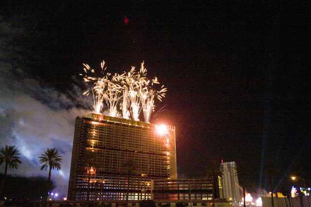 Fireworks explode over the Stardust hotel-casino moments before the iconic casino was imploded early Tuesday morning, March 13, 2007, on the Las Vegas Strip. The legendary Strip casino was implode ...