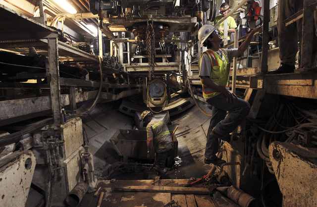 Vegas Tunnel Constructors workers prepare for new concrete slabs to be put in place behind the boring machine as the Southern Nevada Water Authority leads the Review-Journal on a tour of the still ...