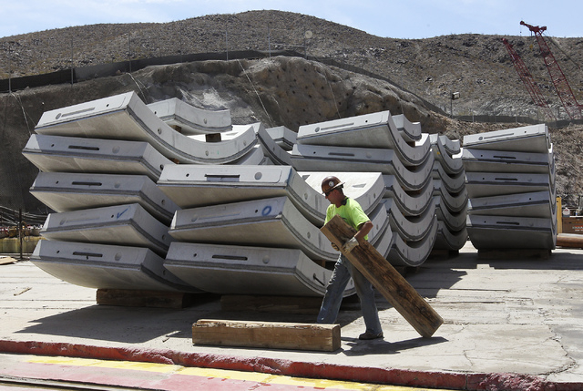 A Vegas Tunnel Constructors worker helps stage the  concrete slabs that are to be put in place behind the boring machine as the Southern Nevada Water Authority leads the Review-Journal on a tour o ...