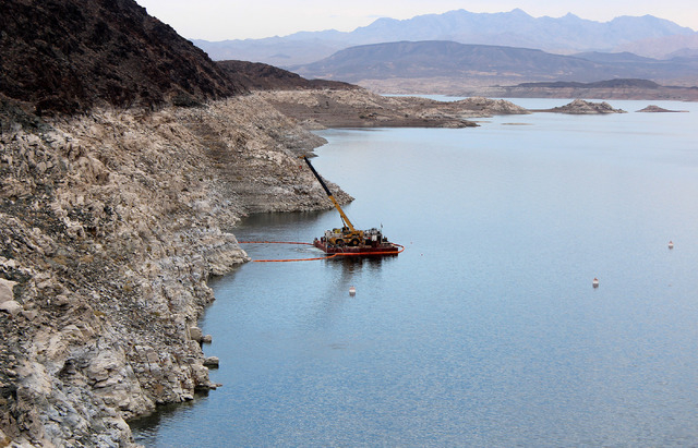 A crew on a barge works on Lake Mead near the opening of Intake No. 1, which will be shut down until March as work is done to connect it to Intake No. 2 and, eventually, the intake now under const ...