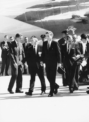 01551: Governor Grant Sawyer, second from left,  escorts President John F. Kennedy from Air Force One at McCarran Airport on September 28, 1963. Senator Alan Bible follows behind Kennedy. Kennedy  ...