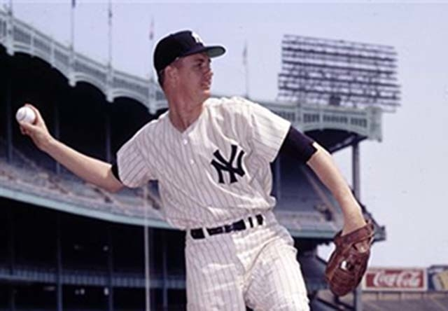 In this Sept. 5, 1957, file photo, New York Yankees pitcher Johnny Kucks poses for a photo at Yankee Stadium in New York. Kucks, who pitched a three-hitter for the Yankees in Game 7 of the 1956 Wo ...